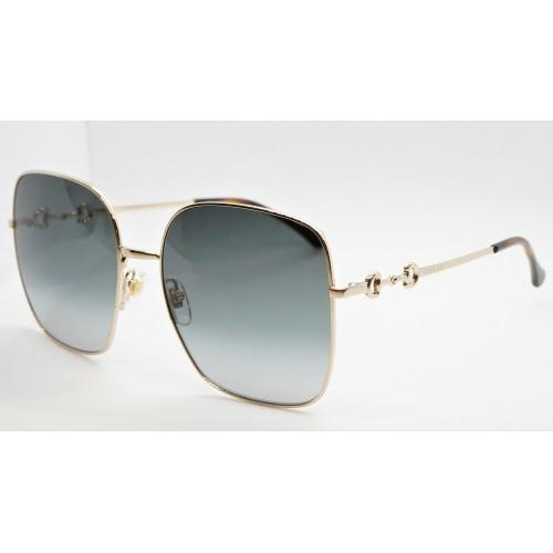 Gucci Okulary przeciwsłoneczne damskie GG0879S 001 - złoty, filtr UV400
